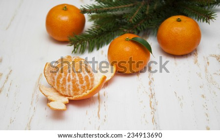 Christmas composition with fresh tangerine and Christmas tree on a white background - stock photo