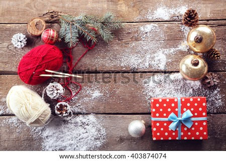 Christmas composition with gift box and decorations on a wooden table - stock photo