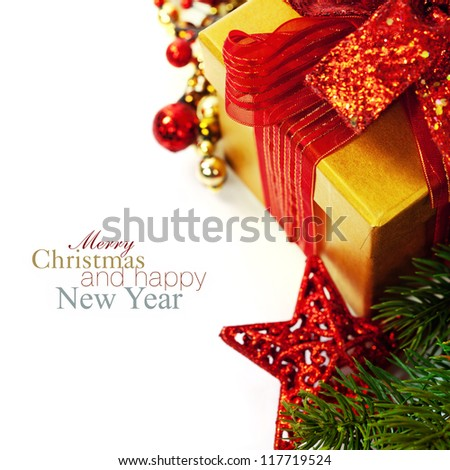 Christmas composition with gift box and decorations (with easy removable sample text) - stock photo