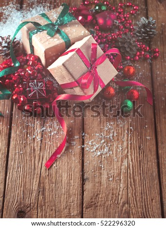 Christmas composition with gifts and decoration on wooden background