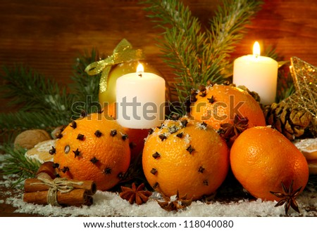 christmas composition with oranges and fir tree, on wooden background - stock photo
