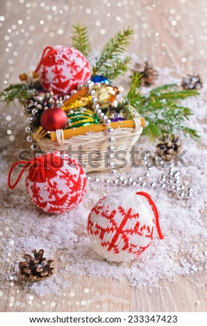Christmas composition with ornaments, pine cones, branches of fir trees and artificial snow