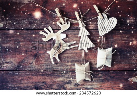 christmas composition with present boxes and fir-cone on wooden background/ Christmas card with christmas rustic decorations - stock photo