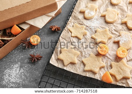 Christmas composition with raw cookies on grey background