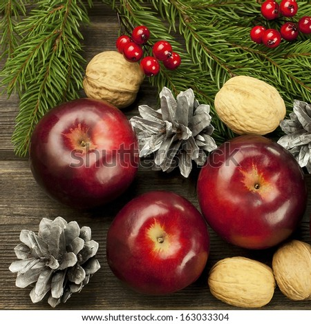 Christmas composition with red apples and walnuts