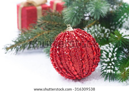 Christmas composition with red ball and gifts, close-up - stock photo