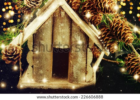 Christmas composition with small bird house. - stock photo