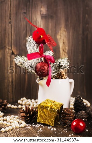 Christmas composition with small red bird and fir tree decorations. Xmas greeting card. Selective focus, vintage style