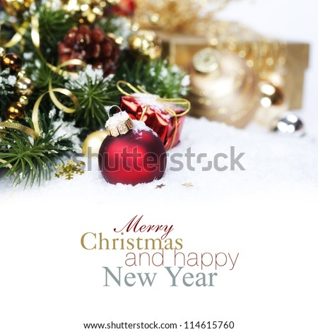 Christmas composition with snow and Christmas decoration (with sample text) - stock photo