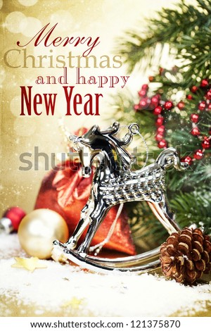 Christmas composition with The rocking-horse. - stock photo