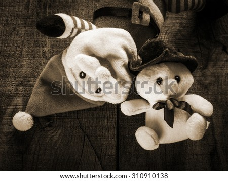 Christmas composition with toy Santa Claus  and snowman against wooden background  - stock photo