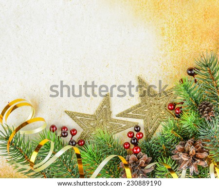 Christmas compositionon with fir branches and golden stars on a background of old paper