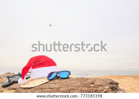 Christmas  Concept,A plane summer holiday background, Beach accessories on the beach, Vacation and travel items,In tropical Phuket Thailand.