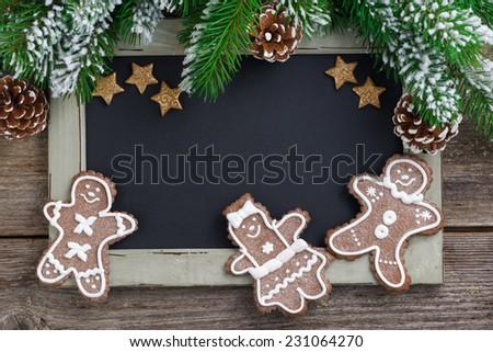 Christmas concept. Black board for text and gingerbread man, top view, horizontal - stock photo