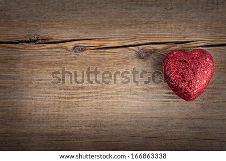 Christmas concept (decoration). Red  heart over rustic wooden background (texture) close up, horizontal. Retro Styled Wallpaper. Valentines Day