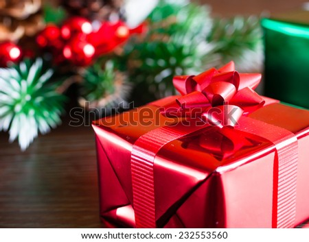 Christmas concept - Present next to a christmas tree