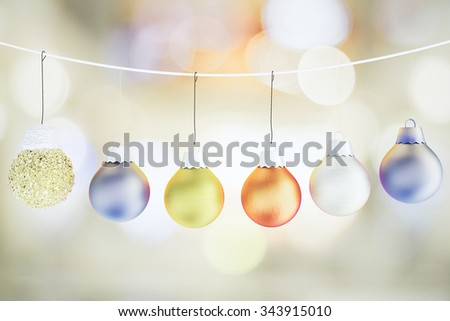 Christmas concept with christmas tree multicolored balls on the rope - stock photo