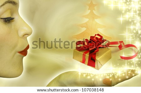 Christmas concept with woman blowing to gift