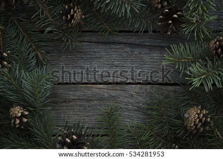 Christmas cone decorated wood background