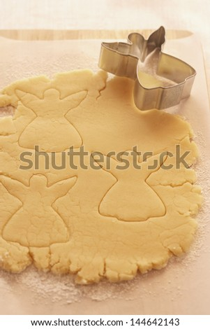 Christmas cookie dough with shape cutter