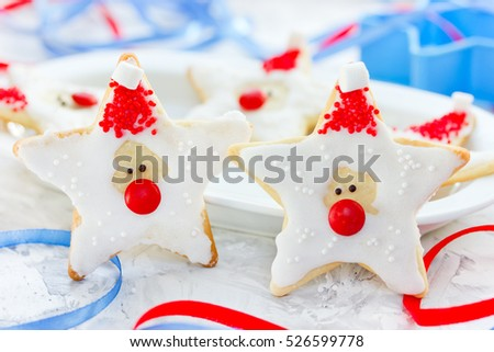 Christmas cookie shaped Santa Claus , Gingerbread cookies with frosting , Christmas and New year Holiday food idea