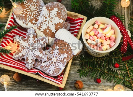 Christmas cookies and cap of coffee on a wooden table