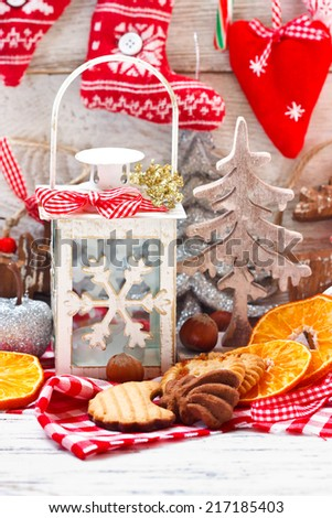 Christmas cookies and christmas decorations with lantern.