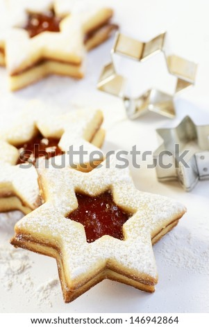 Christmas cookies and cookie cutters on white background. - stock photo