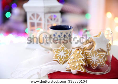 Christmas cookies and cup of tea, on table at home  - stock photo