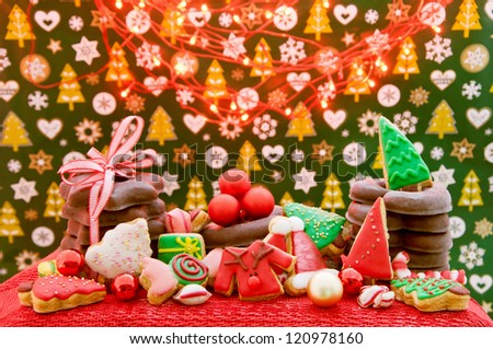 Christmas cookies and gingerbread with decoration and christmas lights - stock photo