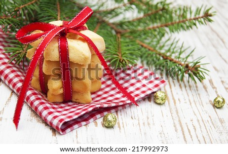 Christmas cookies and pine on a wooden background