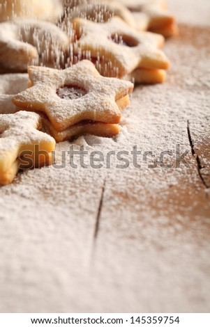 Christmas cookies and pouring sugar- Selective focus and place for copy space. - stock photo
