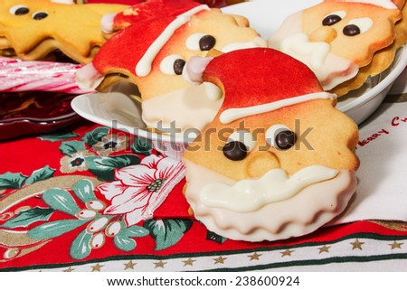 christmas cookies biscuits in the shape of santa claus - stock photo
