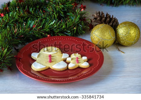 Christmas cookies decorated with fondant on table - stock photo