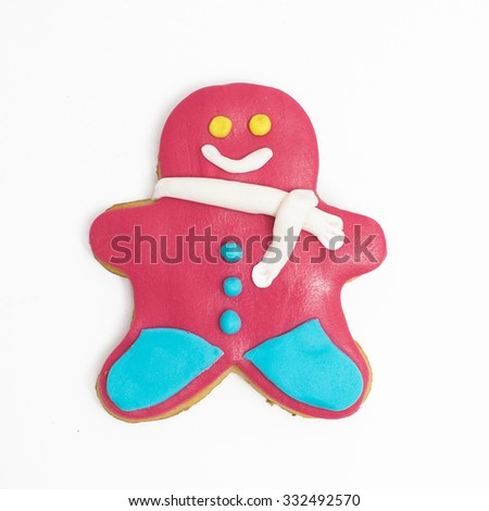 Christmas cookies decorated with fondant on white background