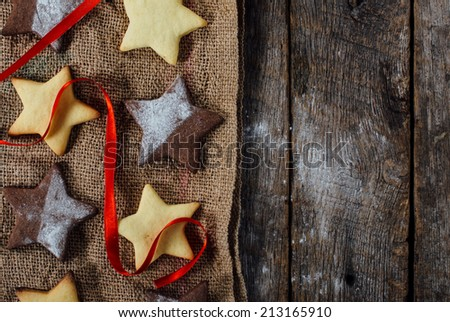 Christmas cookies from above on wooden background with blank space  - stock photo
