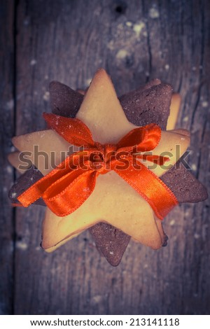 Christmas cookies from above on wooden background with snow - stock photo