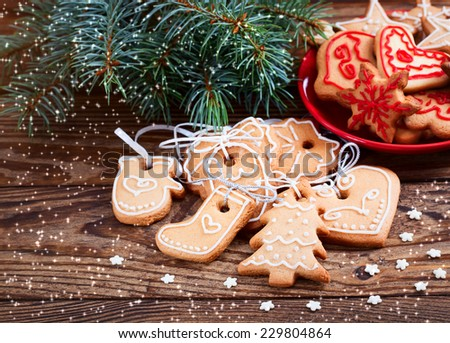 Christmas cookies handmade lies on wooden background. Gingerbread reindeer cookies and christmas decoration.  Christmas tree
