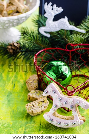 Christmas cookies in a basket on the background of Christmas tree branches - stock photo