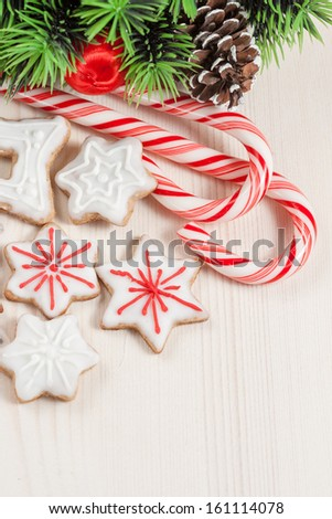 Christmas cookies in a white and red glaze on a white wooden background