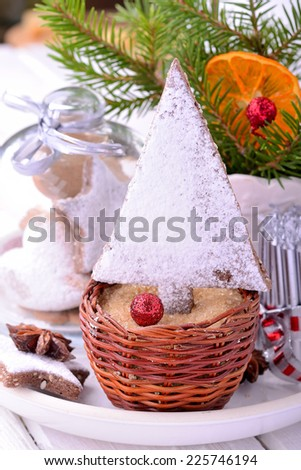 Christmas cookies in Christmas trees and stars xmas decorations on a white plate. selective focus - stock photo