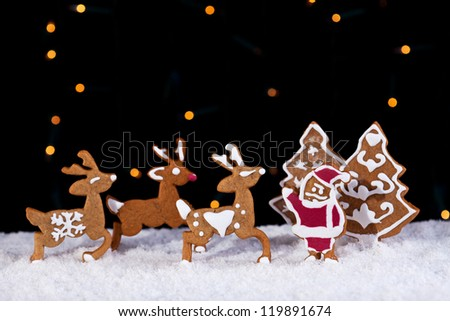 Christmas cookies in holidays greeting card setting - santa with his deers - stock photo