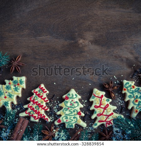 Christmas cookies in the shape of a Christmas tree on a dark wooden background. Retro style - stock photo