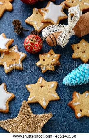 Christmas Cookies in the shape of star and new year bauble on slate background