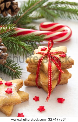 Christmas cookies in the shape of star with festive decoration