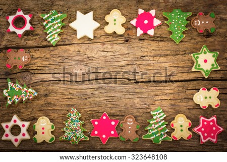 Christmas cookies on the wooden background - stock photo