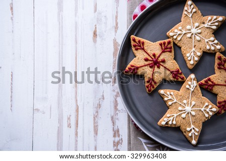 Christmas cookies on wooden background, overhead view - stock photo