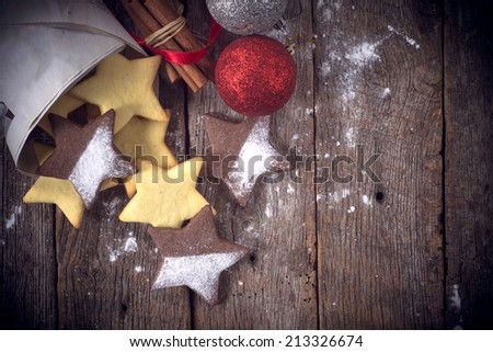 Christmas cookies on wooden background with blank space on the right side - stock photo
