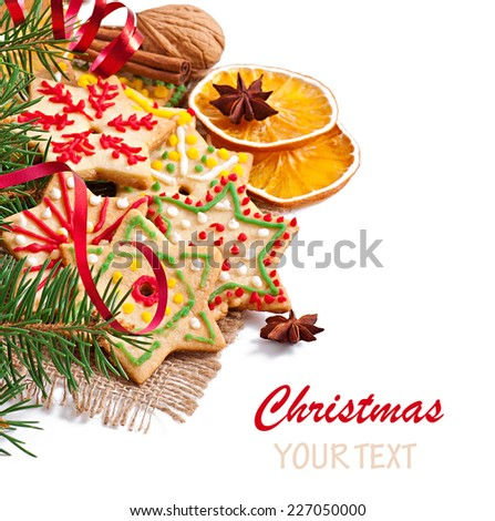 Christmas cookies, spices and spruce branches isolated on white background - stock photo
