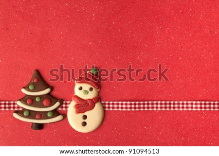 Christmas cookies with beautiful ribbon on red background - stock photo